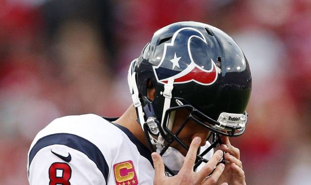 Houston Texans quarterback Matt Schaub wipes his face after throwing a pass in the first half of an NFL football game against the San Francisco 49ers in San Francisco, Sunday, Oct. 6, 2013. (AP Photo/Beck Diefenbach)