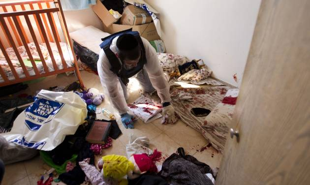 A Zaka volunteers clean blood stains from a children's room in an apartment in a building that was hit by a rocket fired from the Gaza Strip, where three people were killed in Kiryat Malachi, southern Israel, Kiryat Malachi, southern Israel,Thursday, Nov. 15, 2012. Militants in the Hamas-ruled Gaza Strip killed three Israelis on Thursday in a rocket attack liable to deepen a bruising Israeli air, naval and artillery offensive against Palestinian rocket squads. The casualties were the first in Israel since it launched its operation on Wednesday with the assassination of Hamas' top military commander. (AP Photo/Ariel Schalit)
