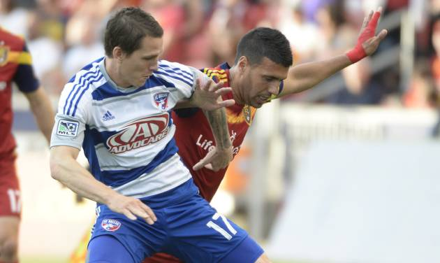 Real Salt Lake midfielder Javier Morales, right, goes for the ball along with FC Dallas defender Zach Loyd (17) during an MLS soccer game on Saturday, May 24, 2014, in Sandy, Utah. (AP Photo/The Salt Lake Tribune, Rick Egan) LOCAL TV OUT; MAGAZINES OUT; DESERET NEWS OUT