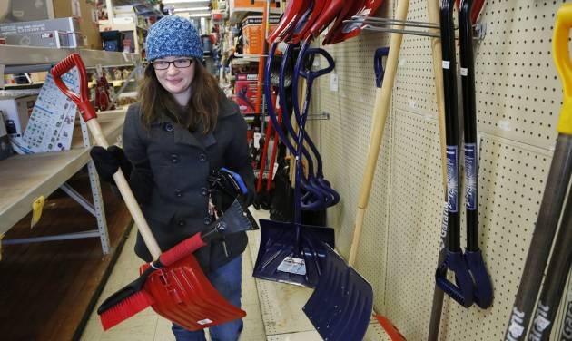FILE - In this Wednesday, Feb. 5, 2014, file photo, Coleen Riley purchases a snow shovel at Ace Hardware, in West Lafayette, Ind. Harsh winter weather has been rough for some businesses, but for a lucky few, it has meant more hard, cold cash. Ace Hardware is having its best winter in more than a decade selling  snowblowers and shovels.  (AP Photo/Journal & Courier, John Terhune, File)