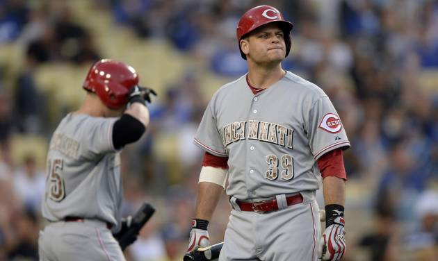 Cincinnati Reds Devin Mesoraco reacts after striking out in the eighth inning of a baseball game against the Los Angeles Dodgers, Monday, May 26, 2014, in Los Angeles. The Dodgers won 4-3. (AP Photo/Gus Ruelas)