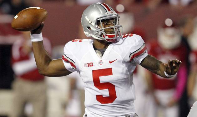FILE - In this Oct. 13, 2012 file photo, Ohio State quarterback Braxton Miller throws during the first half against Indiana in an NCAA college football game in Bloomington, Ind. Rushed into the action as a true freshman, Miller is about to begin his third year as Ohio State's starting quarterback. (AP Photo/Sam Riche, File)