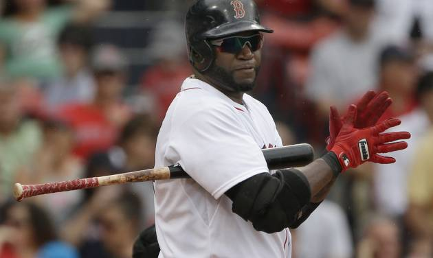 FILE - In this June 26, 2013, file photo, Boston Red Sox designated hitter David Ortiz claps his hands before stepping into the batter's box during an interleague baseball game against the Colorado Rockies at Fenway Park in Boston. Baseball's experiment to boost scoring and interest in the then-lagging American League turned 40 this year, and never has the designated hitter been more of a wedge between the two leagues than in 2013, with interleague play all season long and the potential for a pennant-race-altering effect. (AP Photo/Elise Amendola, File)