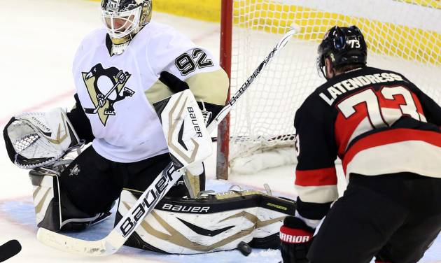 Pittsburgh Penguins goaltender Tomas Vokoun (92) makes a pad save as Ottawa Senators' Guillaume Latendresse (73) looks onduring the second period of their NHL hockey game in Ottawa, Ontario, Monday, April 22, 2013. (AP Photo/The Canadian Press, Fred Chartrand)