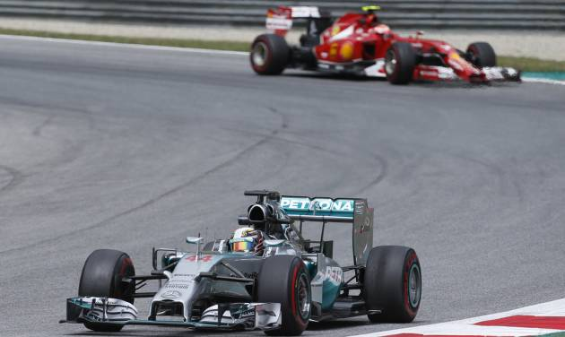 Mercedes driver Lewis Hamilton of Britain steers his car during the second training session at the race track  in Spielberg,  Austria,  Friday, June 20, 2014. The Austrian Formula One Grand Prix will be held on Sunday. (AP Photo/Darko Bandic)
