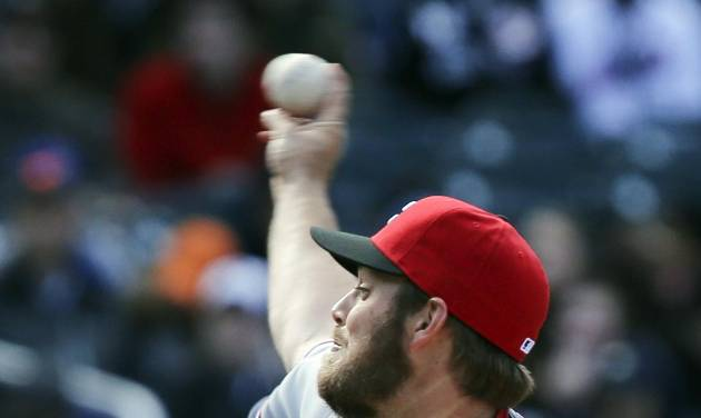 Cincinnati Reds relief pitcher J.J. Hoover throws in the ninth inning of a baseball game against the New York Mets at Citi Field, Saturday, April 5, 2014, in New York. Hoover gave up a grand slam to New York Mets first baseman Ike Davis in the ninth inning to give the Mets the win, 6-3. (AP Photo/John Minchillo)