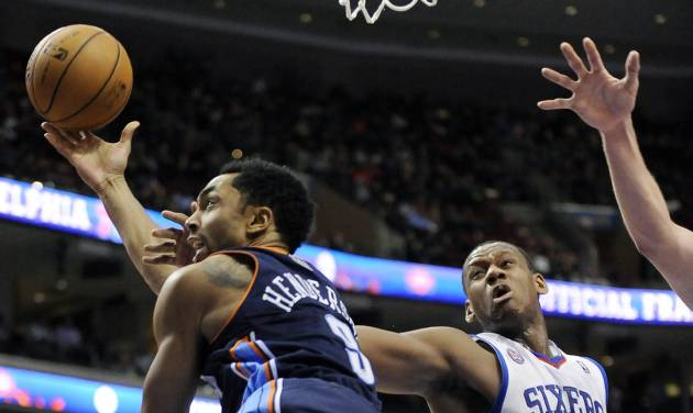Philadelphia 76ers' Lavoy Allen (50) fouls Charlotte Bobcats' Gerald Henderson (9) during the first half of an NBA basketball game, Saturday, Feb. 9, 2013, in Philadelphia. (AP Photo/Michael Perez)