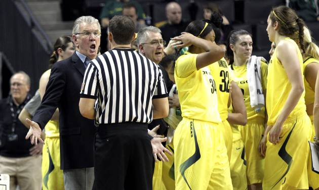 Oregon coach Paul Westhead, left, argues with a referee during a time out in the second half of an NCAA college basketball game against Stanford in Eugene, Ore., Friday, Feb. 1, 2013. Stanford won 86-62. (AP Photo/Don Ryan)