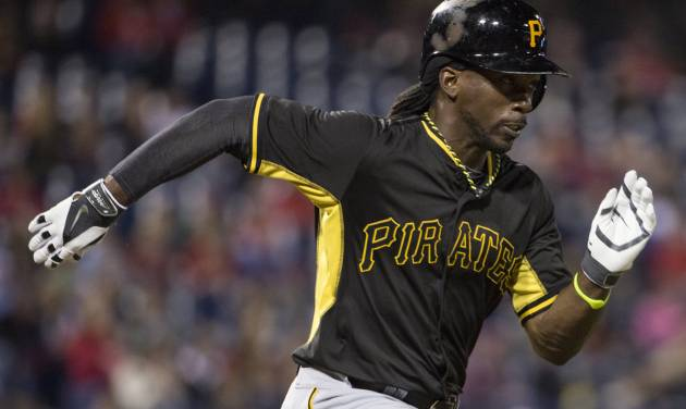 Pittsburgh Pirates' Andrew McCutchen runs to first base on a ground-out during the fourth inning of an exhibition baseball game against the Philadelphia Phillies, Friday, March 28, 2014, in Philadelphia. (AP Photo/Chris Szagola)