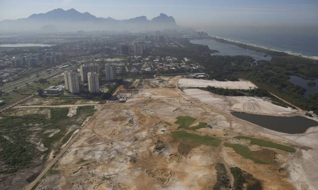 This June 27, 2014 aerial view shows, the Rio 2016 Olympic golf course under construction near the Athletes Village for the Rio 2016 Olympic and Paralympic Games in Rio de Janeiro in Rio de Janeiro, Brazil. Olympic golf course faces an uncertain future after a court proposed Wednesday, Sept. 3, 2014 that the under-construction layout should be modified to meet environmental concerns. Judge Eduardo Klausner, hearing a lawsuit brought against the city of Rio de Janeiro and the course developer, said the defendants had to return on Sept. 17 to say if they could accept the proposal. Klausner said work on the course could continue, but no new areas of vegetation could be plowed under. (AP Photo/Leo Correa)