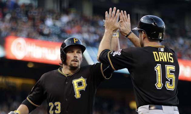 Pittsburgh Pirates' Travis Snider, left, is congratulated by Ike Davis (15) after Snider hit a two run home run off San Francisco Giants' Tim Hudson in the second inning of a baseball game Tuesday, July 29, 2014, in San Francisco. (AP Photo/Ben Margot)