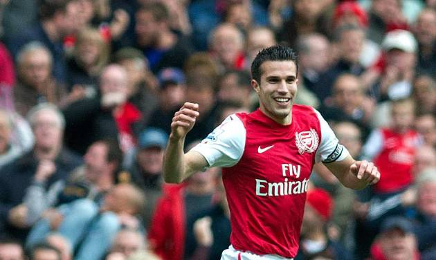 FILE - Arsenal's Robin van Persie reacts against Norwich City, during their English Premier League soccer match at Emirates stadium in London, in this Saturday, May 5 file photo, 2012. Manchester United says Wednesday Aug 15 2012 the club has reached an agreement with Premier League rival Arsenal to buy Netherlands striker Robin van Persie.United says Van Persie is yet to agree to personal terms, with the deal subject to a medical examination. No financial details were disclosed, although British media has reported that Arsenal wanted 20 million pounds ($31.3 million) for its captain, who has one year left on his contract. (AP Photo/Bogdan Maran, File)