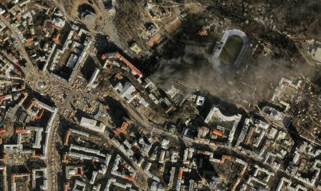 FILE - In this file satellite image provided by Skybox Imaging and taken by SkySat-1 on Tuesday, Feb. 18, 2014 at 11:10 a.m. local time, smoke rises from the site of anti-government protests, upper center, in Kiev, Ukraine. Google is buying Skybox Imaging in a deal that could serve as a launching pad for the Internet company to send its own fleet of satellites to take aerial pictures and provide online access to remote areas of the world. (AP Photo/Skybox Imaging, File) MANDATORY CREDIT