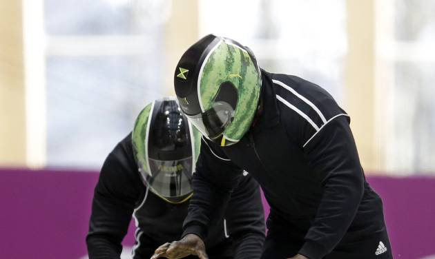 The two-man team from Jamaica JAM-1, piloted by Winston Watts, start a run during a training session for the men's two-man bobsled at the 2014 Winter Olympics, Saturday, Feb. 15, 2014, in Krasnaya Polyana, Russia. (AP Photo/Natacha Pisarenko)