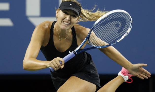 Maria Sharapova, of Russia, watches a return to Sabine Lisicki, of Germany, during the third round of the U.S. Open tennis tournament Friday, Aug. 29, 2014, in New York. (AP Photo/Jason DeCrow)