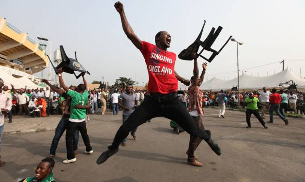 Nigeria soccer fans celebrate after Nigeria soccer player Elderson Echiejile  scored a goal against Mali , during an African Cup of Nations semi final match in Lagos, Nigeria, Wednesday, Feb. 6, 2013. Nigeria cruised to a 4-1 win over Mali on Wednesday to reach the African Cup final for the first time in more than a decade. ( AP Photo/Sunday Alamba)