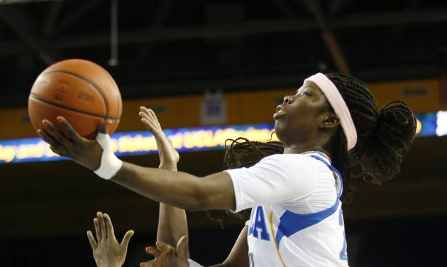 UCLA guard Markel Walker, right, shoots over California guard Eliza Pierre during the second half of an NCAA women's basketball game in Los Angeles, Friday, Feb. 15, 2013. California won 79-51. (AP Photo/Jae C. Hong)