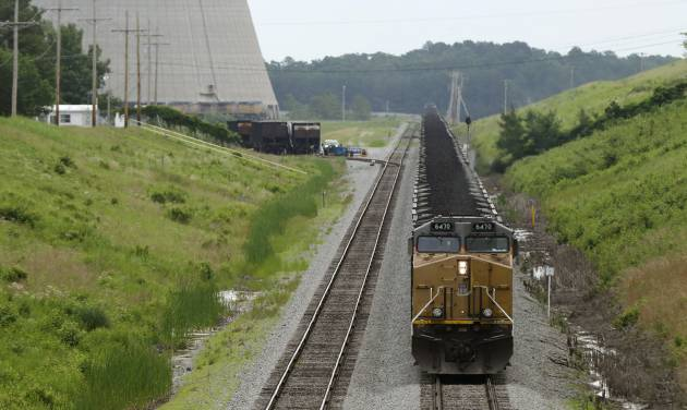 In this photo taken June 2, 2014, a locomotive pulling coal cars is stopped near the White Bluff power plant near Redfield, Ark. The Arkansas Public Service Commission has scheduled a June 25 meeting to explore options for complying with a newly proposed federal air rule regulating carbon dioxide emissions from existing power plants. (AP Photo/Danny Johnston)
