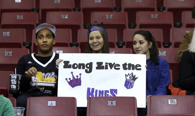 Sacramento Kings fan Jericka Hale, center, shows her support for her team with Bryan Oliver, left, and Chelsea Williams during an NBA basketball game against the Phoenix Suns in Sacramento, Calif., Wednesday, Jan. 23, 2013. The Maloof family, majority owners of the team, have announced they have signed an agreement to sell the Kings to a Seattle Group led by investor Chris Hansen. (AP Photo/Rich Pedroncelli)