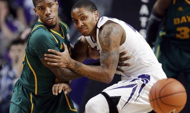 Baylor guard A.J. Walton (22) and Kansas State guard Rodney McGruder (22) watch a loose ball during the first half of an NCAA college basketball game in Manhattan, Kan., Saturday, Feb. 16, 2013. (AP Photo/Orlin Wagner)