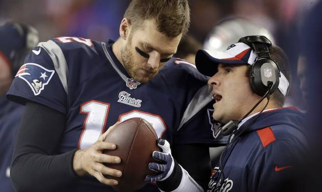 FILE - In this Nov. 3, 2013, file photo, New England Patriots offensive coordinator Josh McDaniels, right, talks to quarterback Tom Brady during the fourth quarter of an NFL football game against the Pittsburgh Steelers in Foxborough, Mass. No name stirs up quite as much angst and anger around Denver as McDaniels. The former Broncos coach, now offensive coordinator for the Patriots, left havoc in the wake of his two-year stint in Denver, and has a chance to leave another scar when the Patriots meet the Broncos in the AFC championship game on Sunday. (AP Photo/Steven Senne, File)