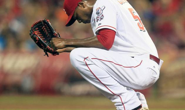Cincinnati Reds relief pitcher Aroldis Chapman squats behind the mound after giving up a three-run home run to Houston Astros' Matt Dominguez in the ninth inning of a baseball game, Friday, Sept. 7, 2012, in Cincinnati. Houston won 5-3. (AP Photo/Al Behrman)