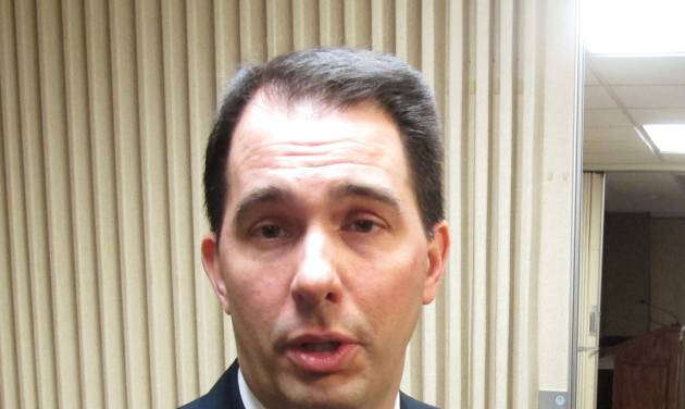Wisconsin Gov. Scott Walker talks about the release of thousands of emails and other documents collected during a criminal investigation of a former aide on Wednesday, Feb. 19, 2014, in Madison, Wis. Walker said he expects his political enemies to use the emails against him, but he doesn't expect there to be any surprises. (AP Photo/Scott Bauer)