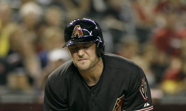 Arizona Diamondbacks' A.J. Pollock reacts after being hit in the hand by Cincinnati Reds pitcher Johnny Cueto during the eighth inning of a baseball game, Saturday, May 31, 2014, in Phoenix. The Reds defeated the Diamondbacks 5-0. (AP Photo/Ralph Freso)