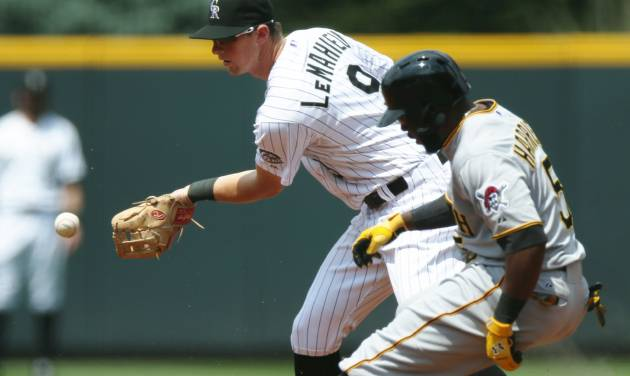 Colorado Rockies second baseman DJ LeMahieu, back, fields throw as Pittsburgh Pirates' Josh Harrison pulls into second base with a double in the first inning of a baseball game in Denver on Sunday, July 27, 2014. (AP Photo/David Zalubowski)
