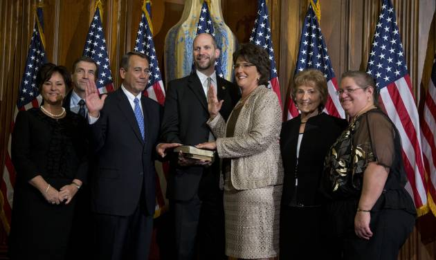 "FILE - In this Jan. 3, 2013, file photo Rep. Jackie Walorski, R-Ind., third from right, participates in a mock swearing-in ceremony with Speaker of the House Rep. John Boehner, R-Ohio, for the 113th Congress on Thursday, Jan. 3, 2013 in Washington. Persuading first-term Republicans in the House is President Barack Obama's toughest sell on military strikes against Syria. Many of the three dozen freshmen come from solidly GOP districts where voters have a deep distrust of the president on health care and immigration. ""I haven't heard a word about how the targeted, limited strikes protect America's national security,"" Walorski said in an interview. ""How does this fit into a long-term plan for the Middle East? What is the endgame?"" (AP Photo/ Evan Vucci, File)"