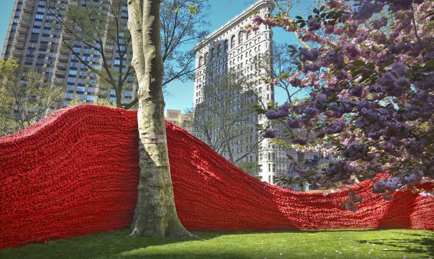 """Part of more than 1.4 million feet of painted, hand-knotted-rope by artist Orly Gender titled """"Red, Yellow and Blue,"""" is installed in Madison Square Park on Wednesday, May 1, 2013 in New York. The installationwill be on view until Sept. 8.   (AP Photo/Bebeto Matthews)"""
