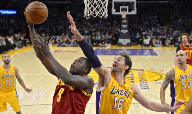 Cleveland Cavaliers forward Luol Deng puts up a shot as Los Angeles Lakers center Pau Gasol defends during the first half of an NBA basketball game, Tuesday, Jan. 14, 2014, in Los Angeles. (AP Photo/Mark J. Terrill)
