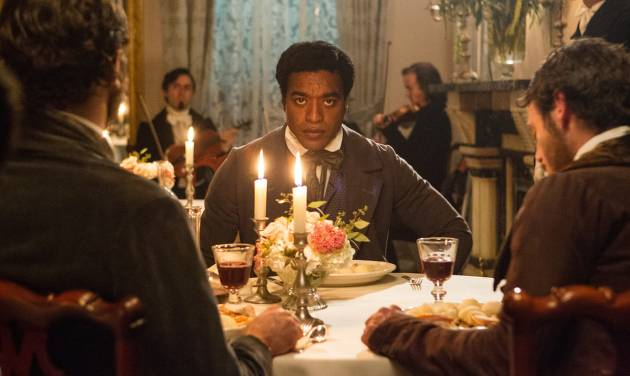"""This film publicity image released by Fox Searchlight shows Chiwetel Ejiofor in a scene from """"12 Years A Slave."""" This year's best picture race at the 86th Academy Awards on Sunday, March 2, 2014, has shaped up to be one of the most unpredictable in years. The favorites are """"12 Years a Slave,"""" """"Gravity"""" and """"American Hustle."""" (AP Photo/Fox Searchlight Films, Jaap Buitendijk, file)"""