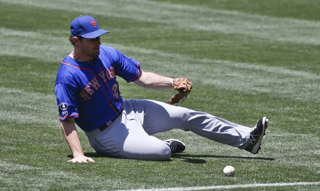 New York Mets second baseman Daniel Murphy chases down a base hit by San Diego Padres' Chris Nelson in the second inning of a baseball game Sunday, July 20, 2014, in San Diego.  (AP Photo/Lenny Ignelzi)