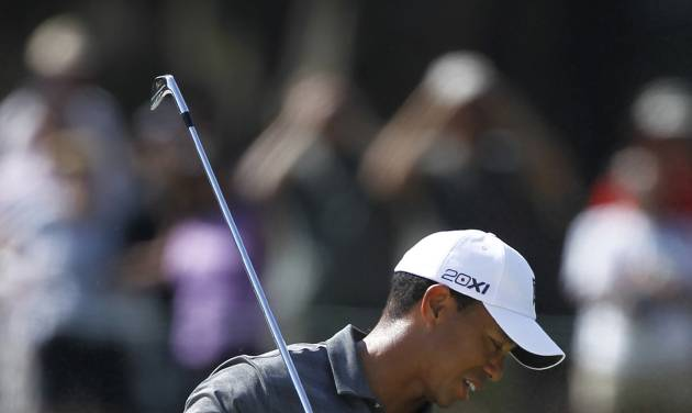 Tiger Woods reacts to his shot from a 15th hole bunker during the first round of the Players Championship golf tournament, Thursday, May 10, 2012, at Sawgrass in Ponte Vedra, Fla. (AP Photo/Chris O'Meara)