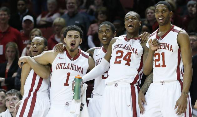 From left to right, Oklahoma's Jordan Woodard, Frank Booker, Je'lon Hornbeak, Buddy Hield and Cameron Clark, celebrate on the bench late in the second half of an NCAA college basketball game against Baylor in Norman, Okla., Saturday, Feb. 8, 2014. Oklahoma won 88-72. (AP Photo/Sue Ogrocki)