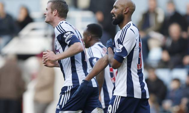 "FILE - This Saturday Dec. 28, 2013 file photo shows West Bromwich Albion's Nicolas Anelka, right, as he gestures to celebrate his goal against West Ham United during their English Premier League soccer match at Upton Park, London. The English Football Association has banned Nicolas Anelka for five games after finding the West Bromwich Albion striker guilty of causing racial offense with a goal celebration deemed anti-Semitic. Anelka had denied that his use of the gesture, which is known in France as a ""quenelle"" and has been described as an ""inverted Nazi salute,"" was anti-Semitic in a Premier League match in December. (AP Photo/Sang Tan, File)"