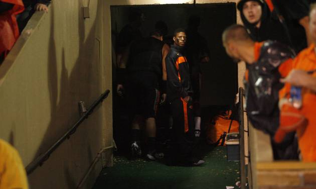 Fans watch as Oklahoma State players look outside the locker room before a college football game between the Oklahoma State University Cowboys  and the University of Tulsa Golden Hurricane at H.A. Chapman Stadium in Tulsa, Okla., Saturday, Sept. 17, 2011. Photo by Sarah Phipps, The Oklahoman