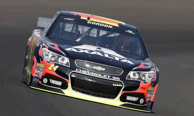 Jeff Gordon drives through turn one during practice for the Brickyard 400 Sprint Cup series auto race at the Indianapolis Motor Speedway in Indianapolis, Saturday, July 26, 2014. (AP Photo/Darron Cummings)