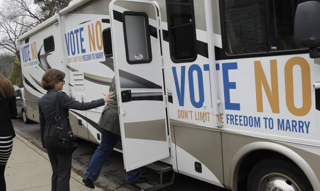 """State Auditor Rebecca Otto enters the RV at a stop in Edina, Minn., on the """"Minnesota Votes No"""" statewide tour Monday, Nov. 5, 2012 in Minneapolis for the final day of the campaign to urge voters to vote against the marriage amendment. Candidates and volunteers worked Monday to make the most of their last 24 hours before decision day, hustling to energize their core supporters and searching for any remaining fence-sitters. Meanwhile, both political parties said they were gearing up like never before to watch the other for any electioneering on Tuesday. (AP Photo/Jim Mone)"""