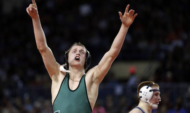 Norman North Hayden Hansen celebrates his win over Edmond North's Josh Breece in the 126-pound match  during the state wrestling tournament at the State Fair Arena in Oklahoma City,  Friday, Feb. 22, 2013. Photo by Sarah Phipps, The Oklahoman