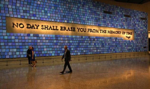 FILE - In this May 15, 2014 file photo, a quote from Virgil fills a wall of the museum prior to the dedication ceremony at the National September 11 Memorial Museum in New York. The museum was designed with the psychological well-being of the public in mind.  But behind the wrenching sights and sounds of the National Sept. 11 Memorial Museum lies a quiet effort to help visitors handle its potentially traumatic impact, from built-in tissue boxes to a layout designed to let people bypass the most intense exhibits if they choose. (AP Photo/The Star-Ledger, John Munson, Pool)