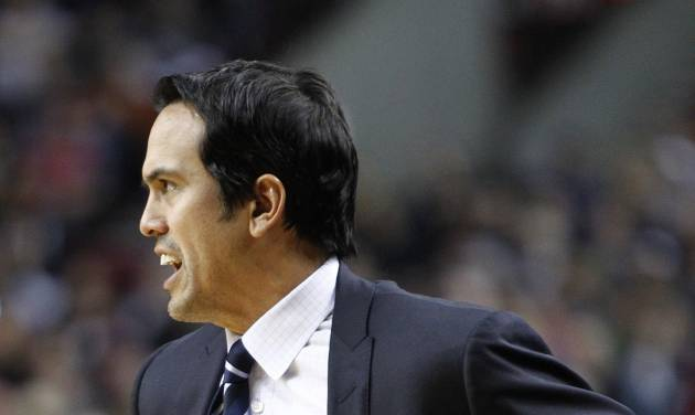 Miami Heat coach Erik Spoelstra watches from the bench during the first quarter of an NBA basketball game against the Portland Trail Blazers in Portland, Ore., Thursday, Jan. 10, 2013. (AP Photo/Don Ryan)