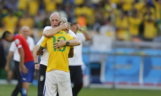 Brazil's coach Luiz Felipe Scolari embraces Brazil's Neymar after the World Cup round of 16 soccer match between Brazil and Chile at the Mineirao Stadium in Belo Horizonte, Brazil, Saturday, June 28, 2014. Brazil won 3-2 on penalties. (AP Photo/Frank Augstein)