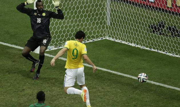 Brazil's Fred scores his side's 3rd goal during the group A World Cup soccer match between Cameroon and Brazil at the Estadio Nacional in Brasilia, Brazil, Monday, June 23, 2014. (AP Photo/Christophe Ena)
