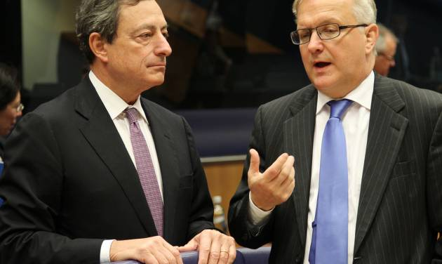 President of the European Central Bank Mario Draghi, left, looks on as he listens to European Commissioner for Economic and Monetary Affairs Olli Rehn, during the Eurogroup meeting, in Luxembourg, Monday Oct. 8, 2012. Finance ministers from the nations sharing the euro currency assess the latest developments in the financial crisis. (AP Photo/Yves Logghe)