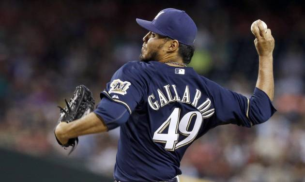 Milwaukee Brewers' Yovani Gallardo throws a pitch against the Arizona Diamondbacks during the first inning of a baseball game on Thursday, June 19, 2014, in Phoenix. (AP Photo/Ross D. Franklin)