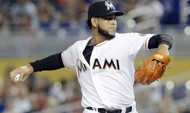 Miami Marlins' Henderson Alvarez delivers a pitch during the first inning of a baseball game against the Philadelphia Phillies, Tuesday, July 1, 2014, in Miami. (AP Photo/Wilfredo Lee)