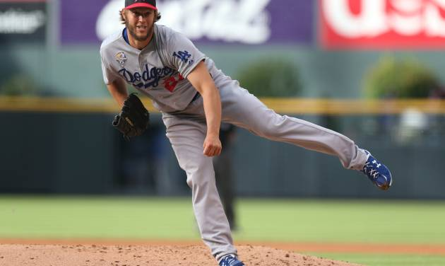 Los Angeles Dodgers starting pitcher Clayton Kershaw works against the Colorado Rockies in the first inning of a baseball game in Denver, Friday, July 4, 2014. (AP Photo/David Zalubowski)