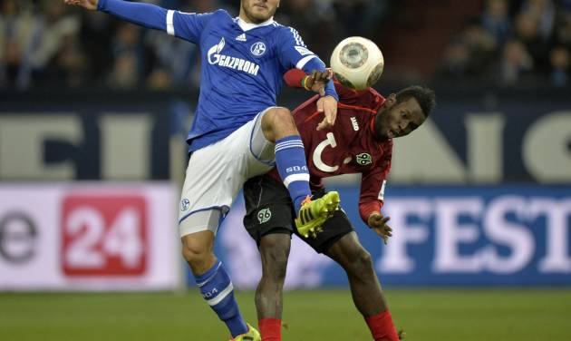 Schalke's Sead Kolasinac, left, and Hannover's Mame Diouf challenge for the ball during the German Bundesliga soccer match between FC Schalke  and SV Hannover in Gelsenkirchen,  Germany, Sunday, Feb. 9, 2014. (AP Photo/Martin Meissner)